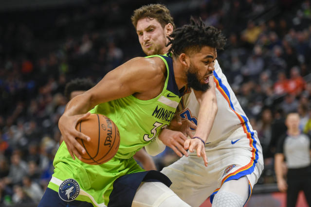 Minnesota Timberwolves center Karl-Anthony Towns collides with Oklahoma City Thunder forward Mike Muscala during the first half of an NBA basketball game Saturday, Jan. 25, 2020, in Minneapolis. (AP Photo/Craig Lassig)