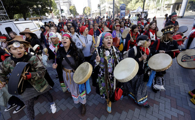 <p>Women drummers sing as they lead a march during an Indigenous Peoples Day event Monday, Oct. 9, 2017, in Seattle, Wash. (Photo: Elaine Thompson/AP) </p>