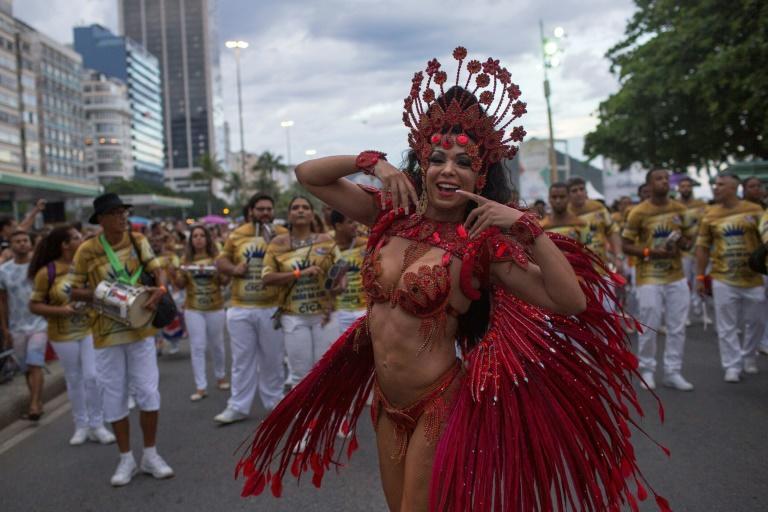 A samba school member dances at a Copacabana beach street party one month ahead of the main carnival parades in Rio de Janeiro