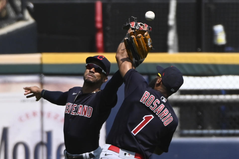 Cleveland Indians center fielder Oscar Mercado, left, and shortstop Amed Rosario (1) try and make a play on a ball hit by Chicago White Sox's Brian Goodwin during the fifth inning of a baseball game, Sunday, Aug. 1, 2021, in Chicago. (AP Photo/Matt Marton)