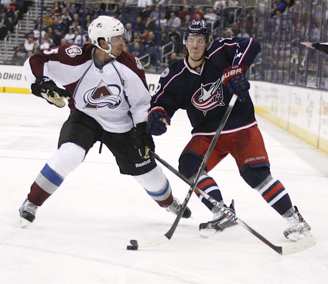 FILE - In this April 1, 2014, file photo, Columbus Blue Jackets' Ryan Johansen, right, collides with Colorado Avalanche's Nate Guenin (5) during the second period of an NHL hockey game in Columbus, Ohio. The Blue Jackets, playing in the postseason for only the second time in franchise history, open the Stanley Cup playoffs at the Pittsburgh Penguins, Wednesday, April 16, 2014. (AP Photo/Mike Munden, File)