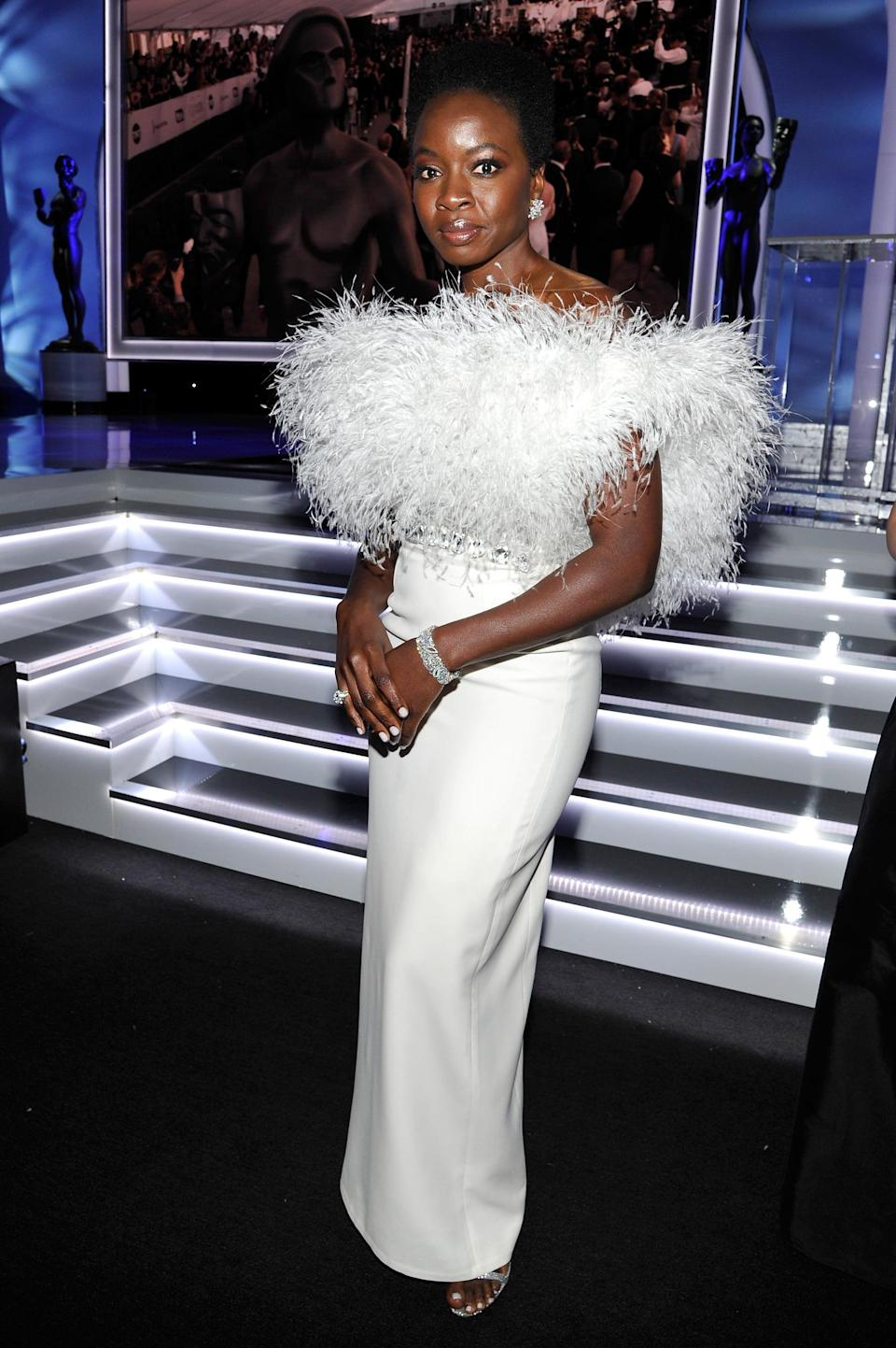 <p>Wearing a white feathered Ralph & Russo gown with Bulgari jewels and Jimmy Choo heels.</p>