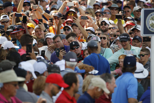 Fan cheer for Tiger Woods as he walks to the 15th tee during a practice round for the PGA Championship golf tournament at Bellerive Country Club, Wednesday, Aug. 8, 2018, in St. Louis. (AP Photo/Charlie Riedel)