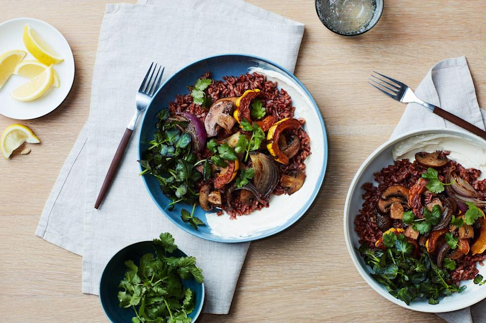 """Make this tasty bowl with the grain of your choosing—red, white, or brown rice, quinoa, or barley are all great. You'll add roasted cremini or button mushrooms, acorn squash, and onion, then nestle it all in a bowl with a swoosh of yogurt sauce. <a href=""""https://www.epicurious.com/recipes/food/views/grain-bowl-with-spiced-squash-mushrooms-and-curried-yogurt?mbid=synd_yahoo_rss"""" rel=""""nofollow noopener"""" target=""""_blank"""" data-ylk=""""slk:See recipe."""" class=""""link rapid-noclick-resp"""">See recipe.</a>"""