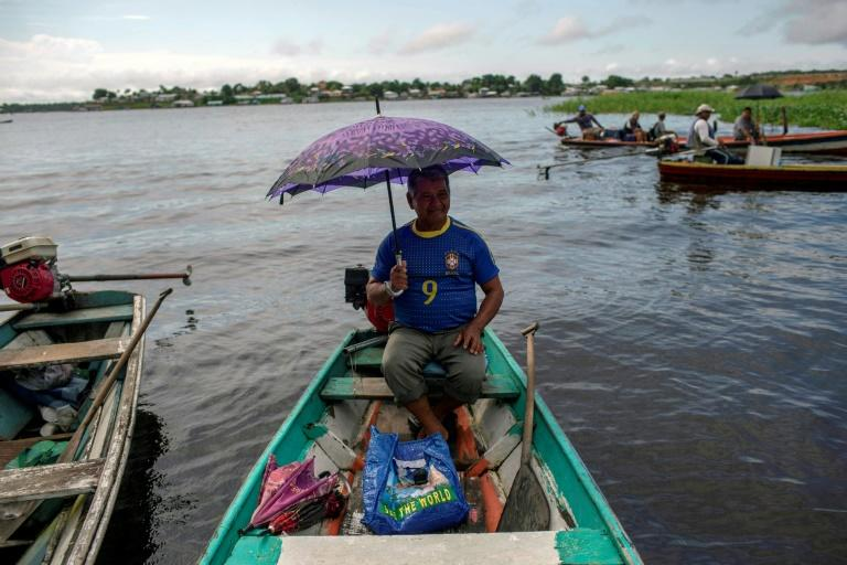 A water taxi driver waits for customers at one of the improvised docks along the riverside in the Amazon city of Tefe -- home to 60,000 people