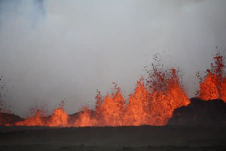 The lava flows on the the ground after the Bardabunga volcano erupted again on August 31, 2014. REUTERS/ArmannHoskuldsson