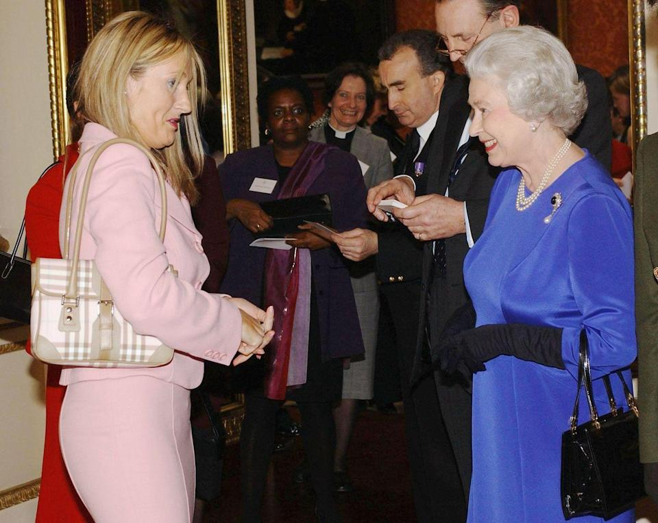 <p>The <em>Harry Potter</em> author opted for a light pink monochrome suit and paired it with a pale pink Burberry purse. How 2004 of her.</p>