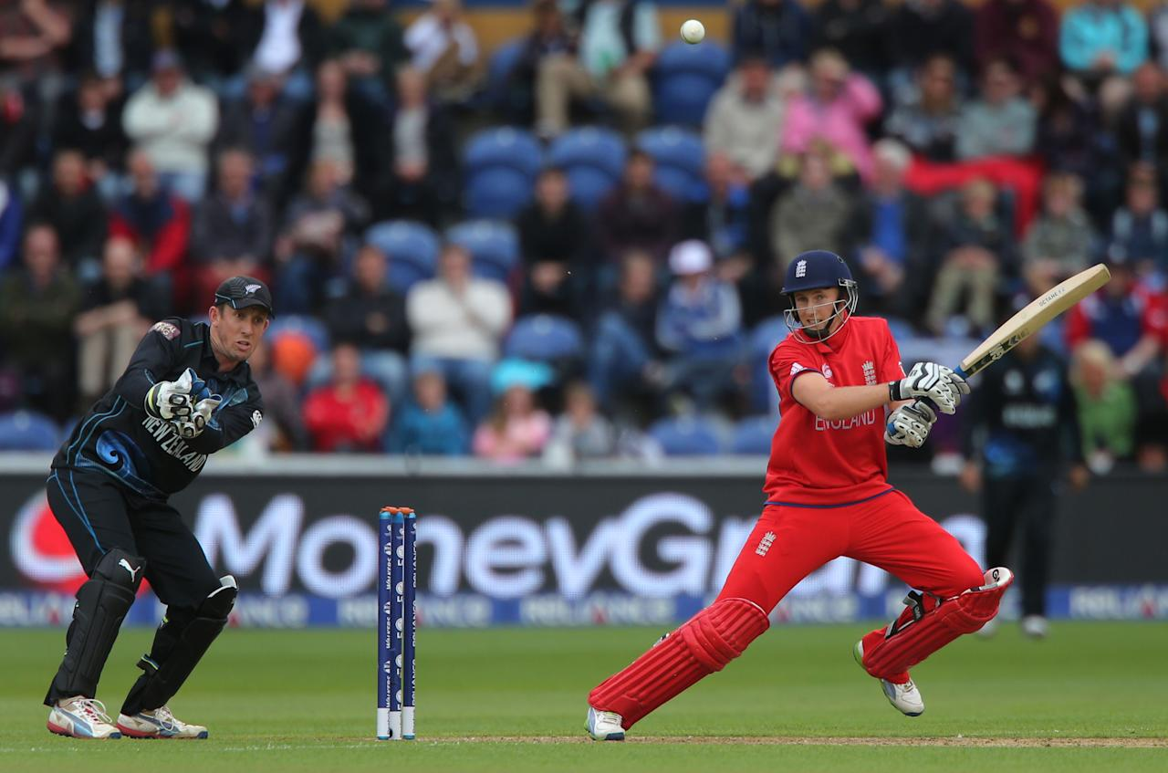 England captain Joe Root square cuts watched by New Zealand wicketkeeper Luke Ronchi, at the SWALEC Stadium, Cardiff.