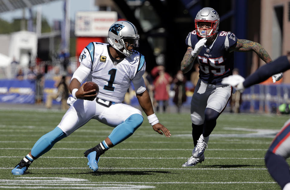 Carolina Panthers quarterback Cam Newton (1) scrambles as New England Patriots defensive end Cassius Marsh (55) gives chase during the first half of an NFL football game, Sunday, Oct. 1, 2017, in Foxborough, Mass. (AP Photo/Steven Senne)