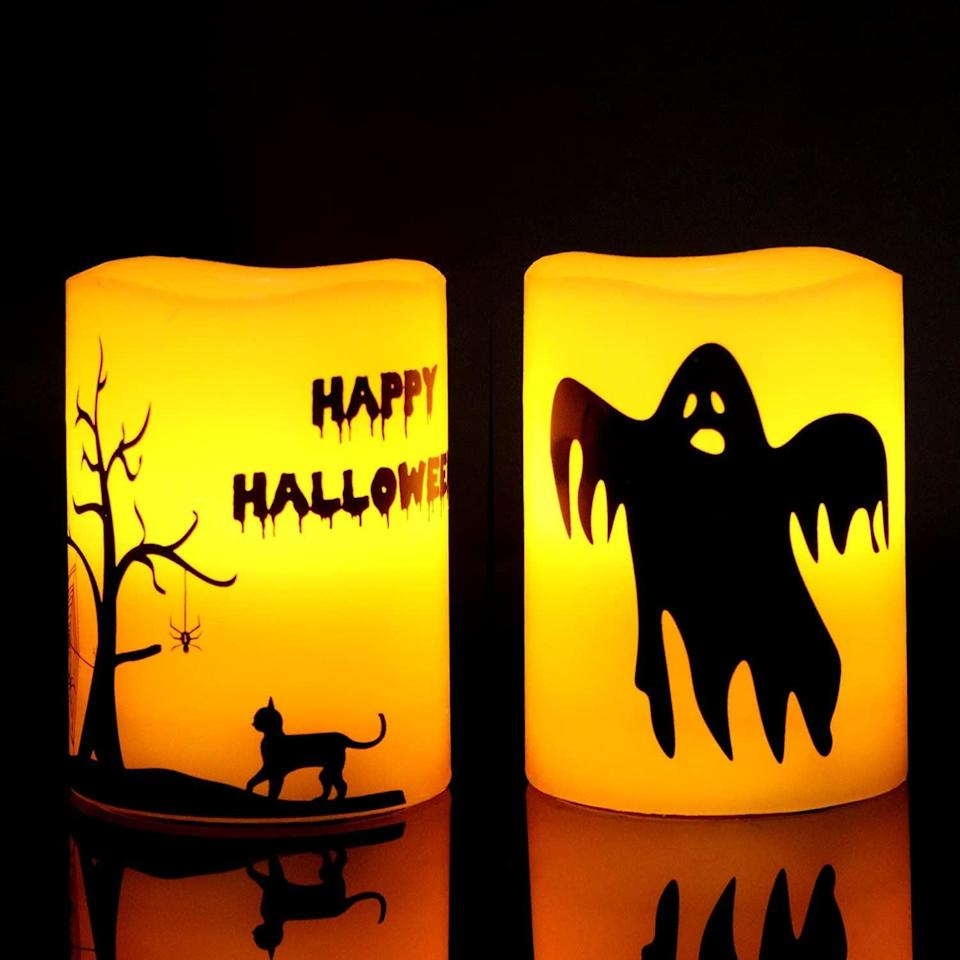 <p>Real candles might pose a fire hazard in your dorm, but these <span>GenSwin LED Halloween Ghost Cat Flameless Candles</span> ($14) are perfectly harmless and add a fun and festive touch to your space. </p>