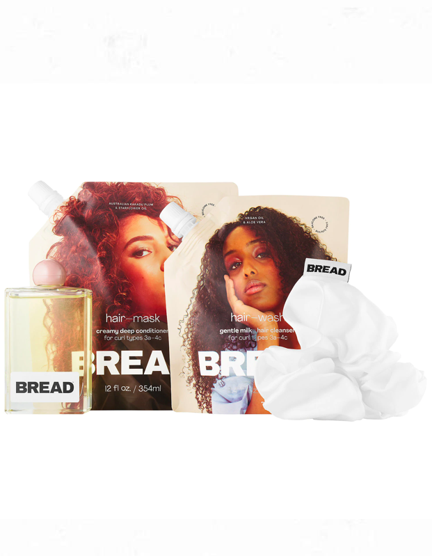 "Meet the new need-to-know brand for textured hair, <a href=""https://shop-links.co/1712363621271025275"" rel=""nofollow noopener"" target=""_blank"" data-ylk=""slk:Bread Beauty Supply"" class=""link rapid-noclick-resp"">Bread Beauty Supply</a>. The <a href=""https://www.glamour.com/gallery/black-owned-beauty-brands?mbid=synd_yahoo_rss"" rel=""nofollow noopener"" target=""_blank"" data-ylk=""slk:Black-owned brand"" class=""link rapid-noclick-resp"">Black-owned brand</a> just launched at Sephora, and is ideal for amping up wash day for the curly girl on your list. $58, Sephora. <a href=""https://www.sephora.com/product/bread-beauty-wash-day-essentials-kit-for-curly-textured-hair-P460552"" rel=""nofollow noopener"" target=""_blank"" data-ylk=""slk:Get it now!"" class=""link rapid-noclick-resp"">Get it now!</a>"
