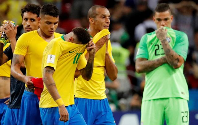<p>Brazil's Neymar, Miranda and team mates look dejected at the end of the match REUTERS/Toru Hanai </p>