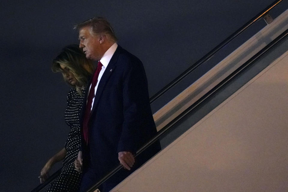 President Donald Trump and first lady Melania Trump step off Air Force One at Palm Beach International Airport, Wednesday, Dec. 23, 2020, in Palm Beach, Fla. Trump is visiting his Mar-a-Lago resort. (AP Photo/Patrick Semansky)