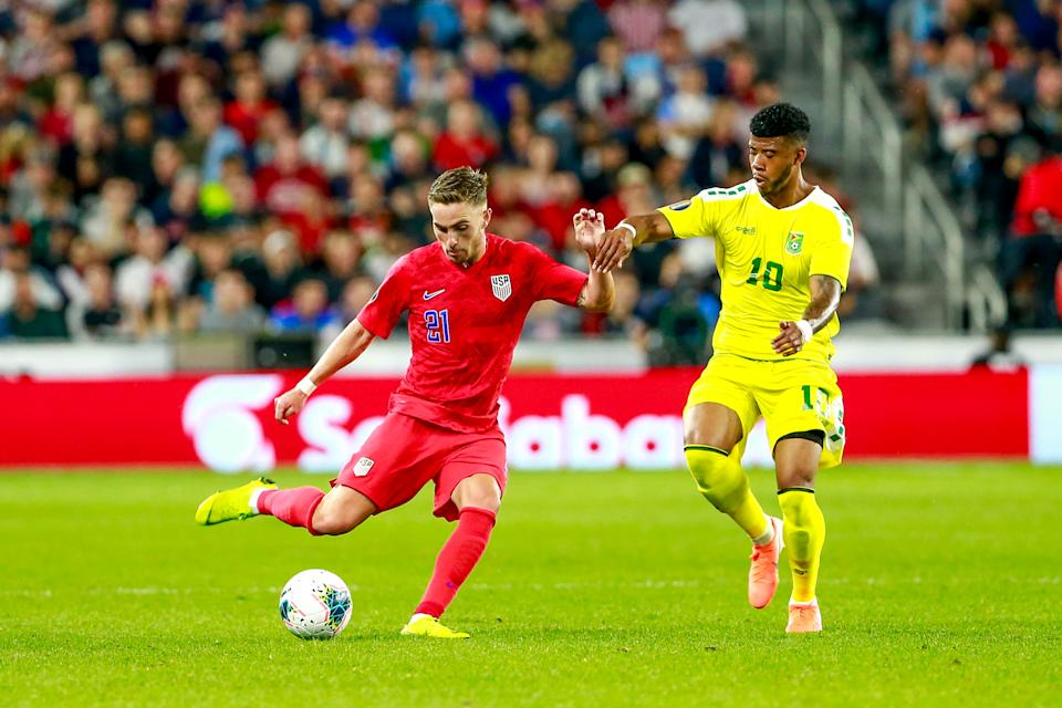 USA's forward Tyler Boyd (#21) vies for the ball with Guyana's forward Emery Welshman (#10) during the 2019 CONCACAF Gold Cup Group D match between USA and Guyana on June 18, 2019 at Allianz Field in Saint Paul, Minnesota. (Photo by Kerem Yucel / AFP)        (Photo credit should read KEREM YUCEL/AFP/Getty Images)
