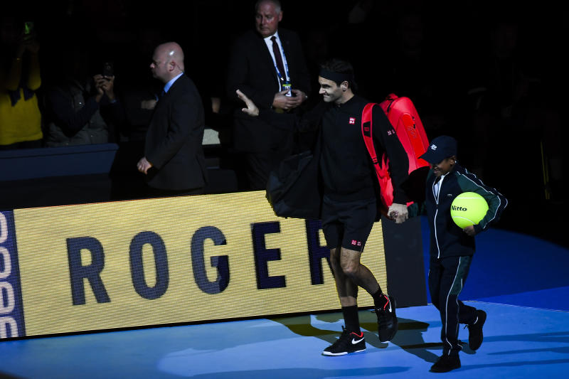 Roger Federer of Switzerland enters the court prior to his match against Novak Djokovic of Serbia during their ATP World Tour Finals singles tennis match at the O2 Arena in London, Thursday, Nov. 14, 2019. (AP Photo/Alberto Pezzali)