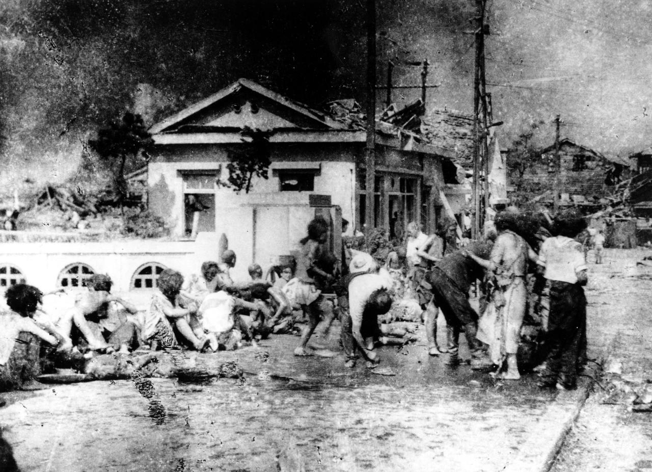 """<p>Japanese victims wait to receive first aid in the southern part of Hiroshima, Japan, a few hours after the U.S. atomic bomb exploded in the heart of the city on Aug. 6, 1945. The explosion of the first A-bomb, known as """"Little Boy,"""" instantly killed 66,000 people and injured another 69,000 people. (AP Photo) </p>"""