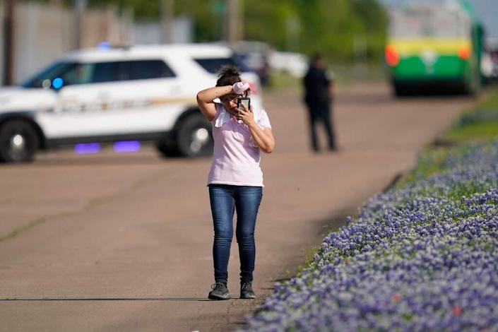 An employee of a local company spoke on the phone on April 8, 2021, after police released her from the scene of a mass shooting in an industrial park in Brian, Texas.