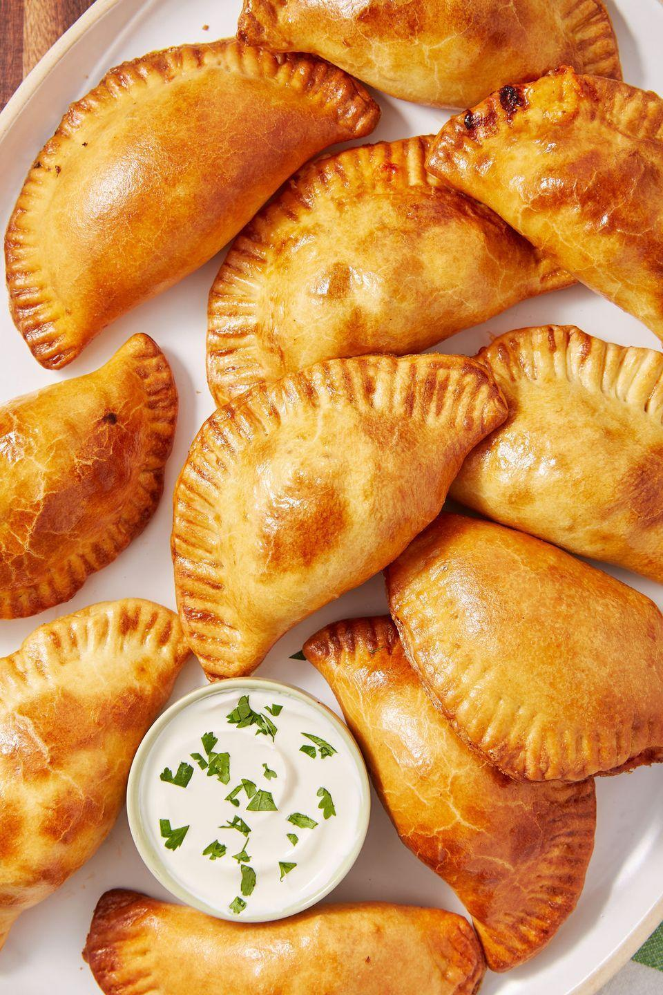 """<p>Perfectly flaky and golden crust and it's done in no time! </p><p>Get the recipe from <a href=""""https://www.delish.com/cooking/recipe-ideas/a52606/beef-empanadas-recipe/"""" rel=""""nofollow noopener"""" target=""""_blank"""" data-ylk=""""slk:Delish"""" class=""""link rapid-noclick-resp"""">Delish</a>. </p>"""