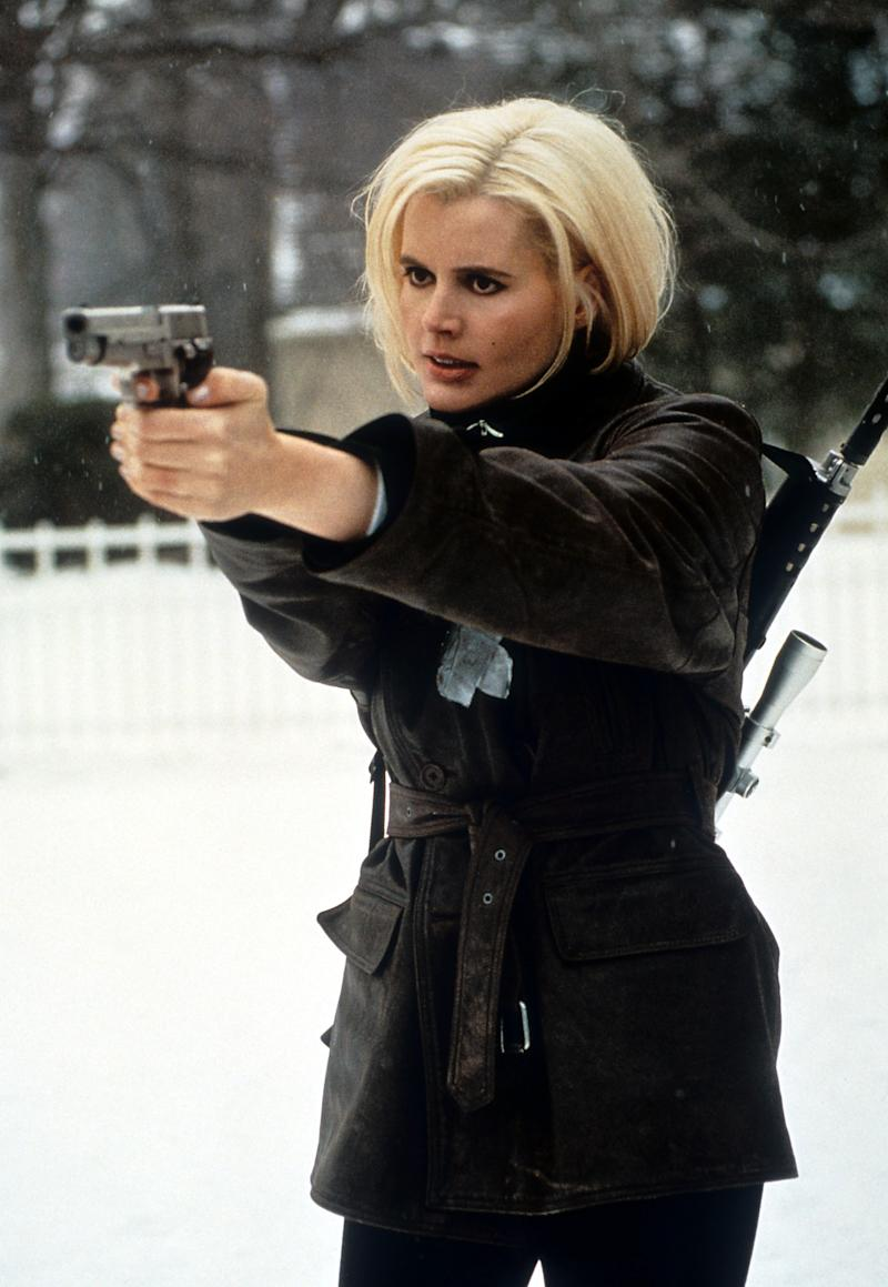 Geena Davis pointing a gun with two hands in a scene from the film 'Long Kiss Goodnight', 1996. (Photo by New Line Cinema/Getty Images)