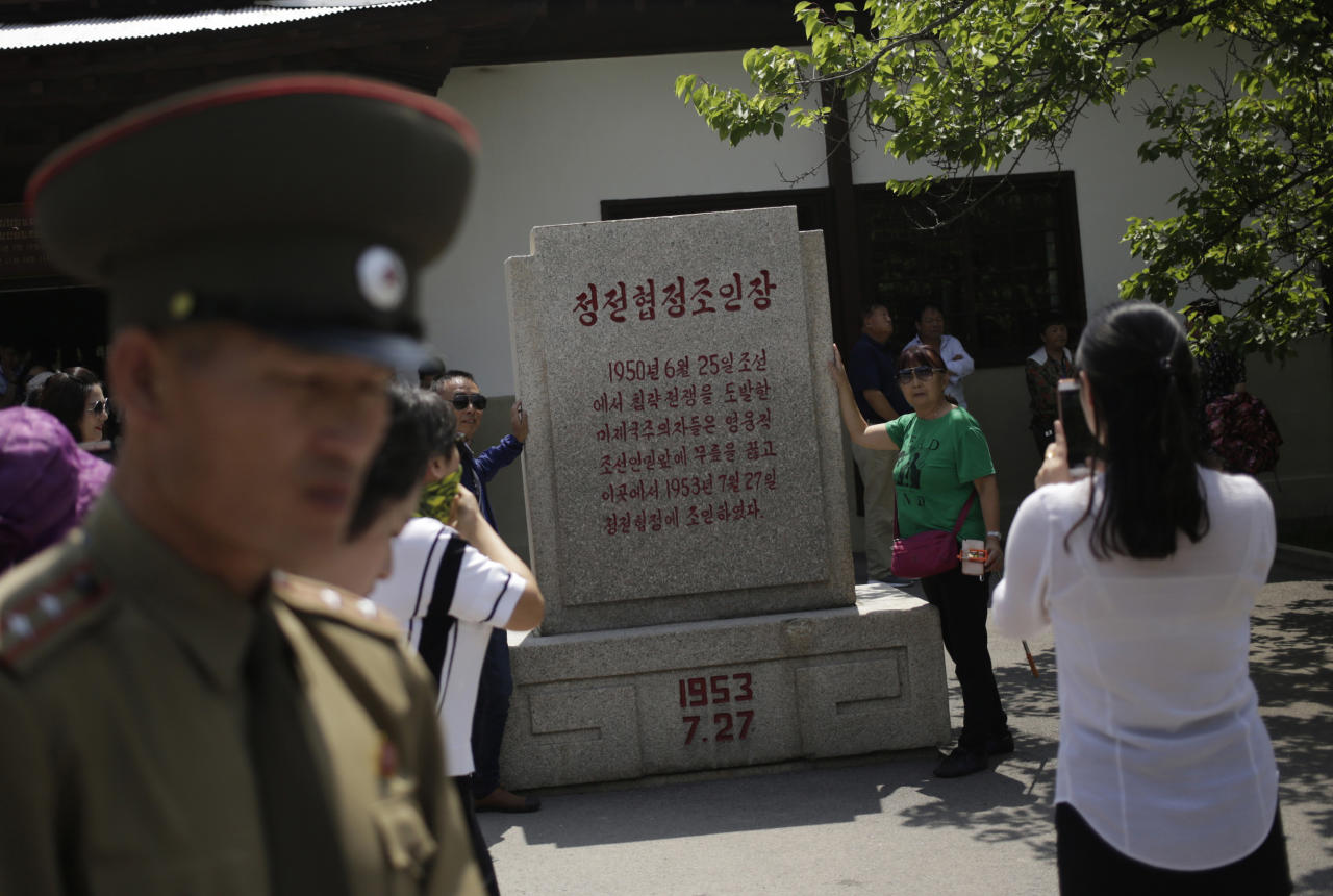 Chinese tourists have their photos taken outside the museum of the armistice agreement between North and South Korea at the truce village of Panmunjom at the Demilitarized Zone (DMZ) which separates the two Koreas in Panmunjom, North Korea, Wednesday, June 20, 2018. Since the summits between North Korean leader Kim Jong Un and the presidents of South Korea and the United States, things have quieted down noticeably in perhaps the most iconic symbol of the one last place on Earth where the Cold War still burns hot. (AP Photo/Dita Alangkara)