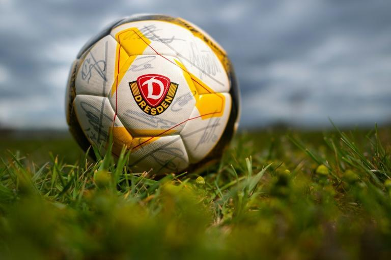 A file picture shows a ball bearing the logo of the German second division Bundesliga football club Dynamo Dresden