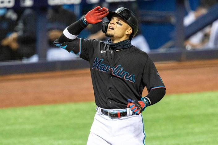 Miami Marlins infielder Isan Diaz (1) reacts after hitting a grand slam during the third inning of an MLB game against the Milwaukee Brewers at loanDepot park in the Little Havana neighborhood of Miami, Florida, on Friday, May 7, 2021.