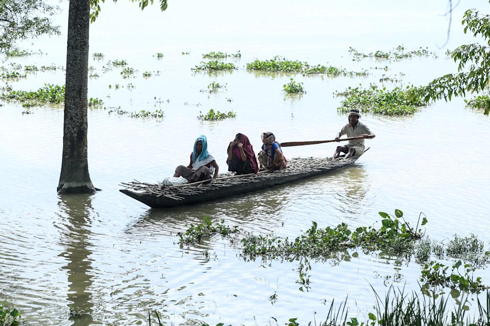 Villagers travel on a boat at the flood affected area of Laibil village in Sibsagar district of Assam, India, on July 22, 2020. (Photo by Dimpy Gogoi/NurPhoto via Getty Images)