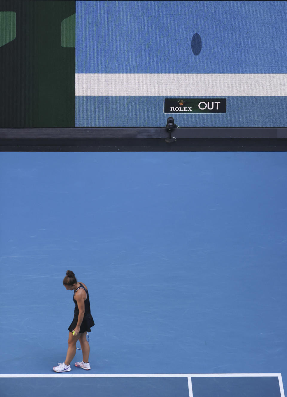 Italy's Sara Errani waits as a video screen shows the line decision during her second round match agains Venus Williams of the US at the Australian Open tennis championship in Melbourne, Australia, Wednesday, Feb. 10, 2021. Eliminating all line judges and removing the human element from officiating at the Australian Open might have been a necessary step to reduce the number of people on court amid a pandemic. It also might be good for the integrity of the game, because getting every call right matters so much to players and fans. (AP Photo/Hamish Blair)