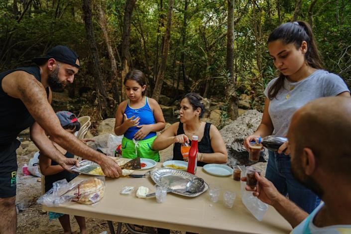 A family picnic along the Awali river in Bisri Valley, Lebanon.