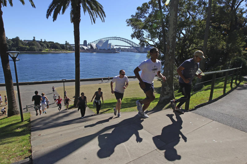 In this Aug. 16, 2012 photo, people run up and down stairs in a park adjacent to the Sydney Opera House and Harbour Bridge in Sydney, Australia. You can enjoy the bridge's breathtaking views of the city skyline, Opera House and harbor for free.(AP Photo/Rick Rycroft)