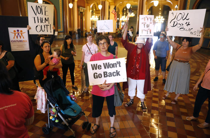 """<span class=""""s1"""">Protesters rally at the office of Iowa Gov. Kim Reynolds in May, urging her to veto a bill that would give the state the strictest abortion restrictions in the nation. She signed it. (Photo: Charlie Neibergall/AP)</span>"""