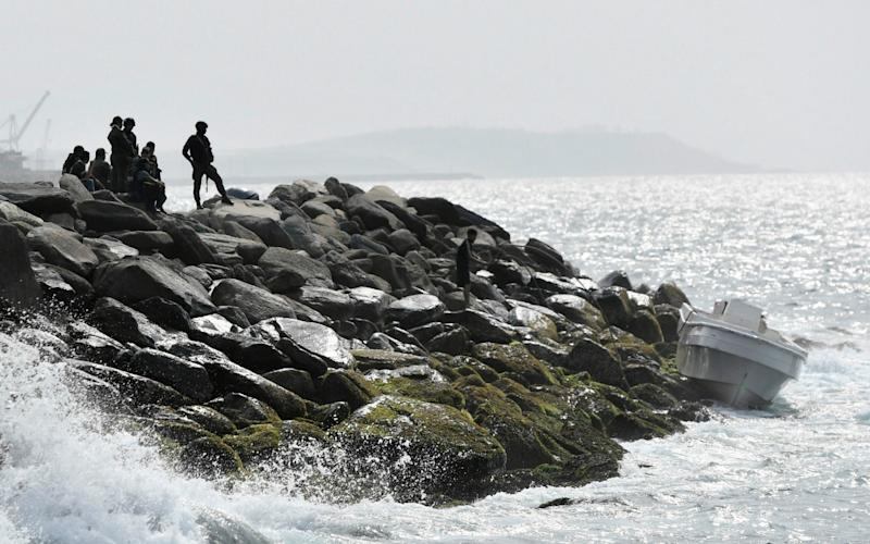 In this May 3, 2020 photo, security forces guard the shore area and a boat in which authorities claim a group of armed men landed - AP Photo/Matias Delacroix, File
