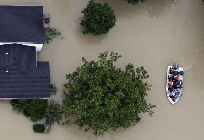 <p>Residents evacuate their homes near the Addicks Reservoir as floodwaters from Tropical Storm Harvey rise Tuesday, Aug. 29, 2017, in Houston. (Photo: David J. Phillip/AP) </p>