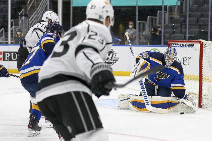 St. Louis Blues goaltender Jordan Binnington (50) stops a shot during the first period of the team's NHL hockey game against the Los Angeles Kings on Wednesday Feb. 24, 2021, in St. Louis. (AP Photo/Scott Kane)