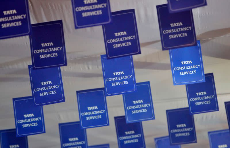 Logos of TCS are displayed at the venue of the annual general meeting of the software services provider in Mumbai
