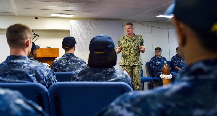 """In this photo released by the U.S. Navy, Vice Adm. Sam Paparo speaks to sailors about the amphibious assault ship USS Iwo Jima off Mayport, Florida, Sept. 20, 2017. Paparo, now the top U.S. Navy official in the Mideast, said Sunday, Dec. 6, 2020, that America has reached an """"uneasy deterrence"""" with Iran after months of regional attacks and seizures at sea, even as tensions remain high between Washington and Tehran over the Islamic Republic's nuclear program. (Mass Communication Specialist Seaman Michael Lehman/U.S. Navy via AP)"""