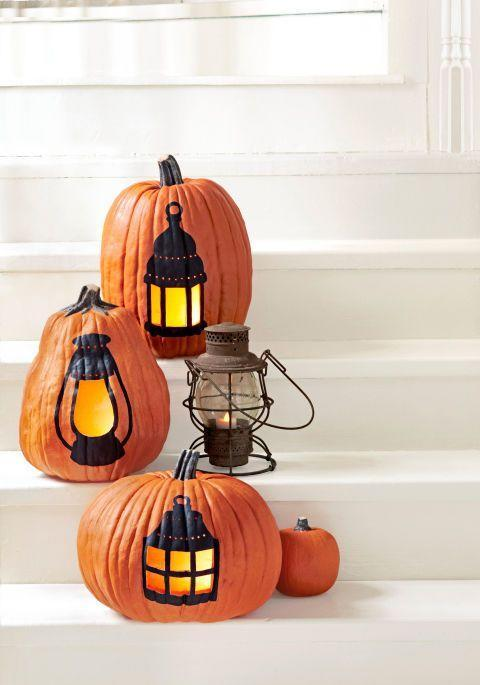 "<p>Light the way up the front walk or porch steps with <a href=""https://www.housebeautiful.com/entertaining/holidays-celebrations/g2627/pumpkin-decorating-ideas/"" rel=""nofollow noopener"" target=""_blank"" data-ylk=""slk:painted pumpkins"" class=""link rapid-noclick-resp"">painted pumpkins</a> featuring cut-out ""panes."" </p><p>Get the tutorial at <em><a href=""http://www.countryliving.com/diy-crafts/how-to/a3031/lantern-pumpkin-1009/"" rel=""nofollow noopener"" target=""_blank"" data-ylk=""slk:Country Living"" class=""link rapid-noclick-resp"">Country Living</a>.</em></p>"