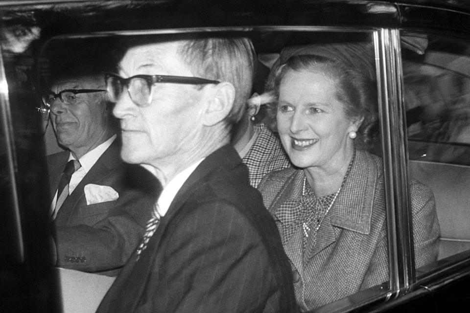 Prime Minister Margaret Thatcher, and her husband Denis, left rear, in Crathie when they joined the Queen and the Royal Family for morning service at the Parish church. The Thatchers have been staying with the Queen at nearby Balmoral castle.   (Photo by PA Images via Getty Images)
