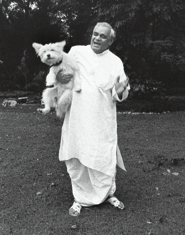 <p>A jovial Atal Bihari Vajpayee with a pet dog. </p>