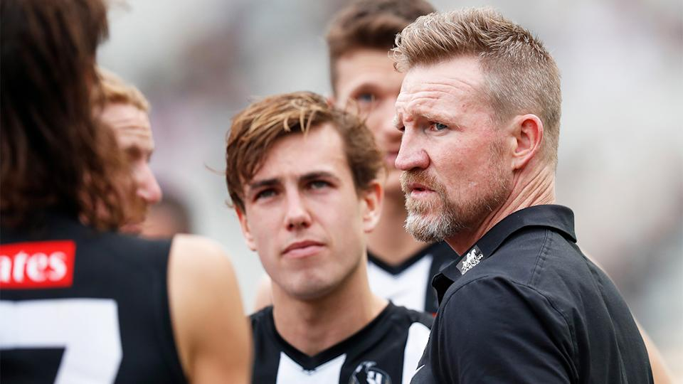 Nathan Buckley (pictured right) speaking to his team at half-time.