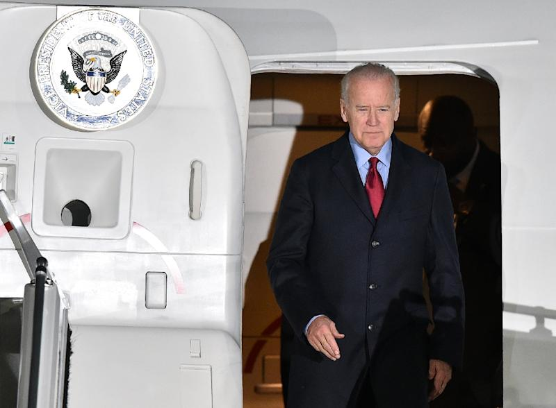 United States Vice President Joe Biden steps out of his plane at the Boryspil International Airport in Kiev on December 7, 2015 (AFP Photo/Genya Savilov)