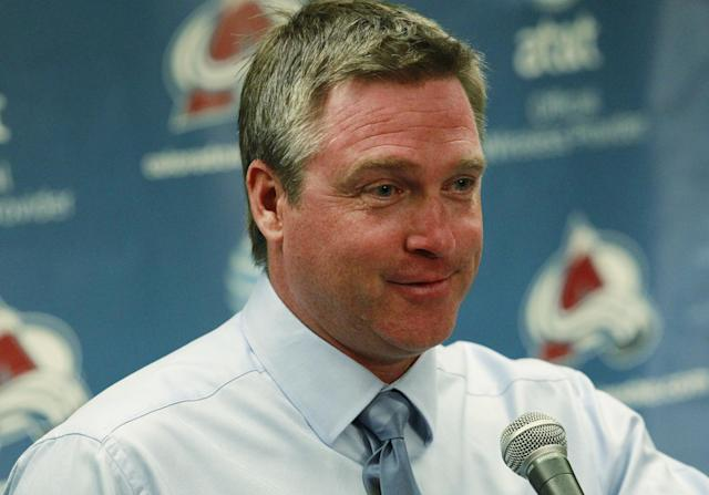 Colorado Avalanche head coach Patrick Roy smiles as he takes questions after the Avalanche's 6-1 victory over the Anaheim Ducks in a hockey game in Denver on Wednesday, Oct. 2, 2013. (AP Photo/David Zalubowski)