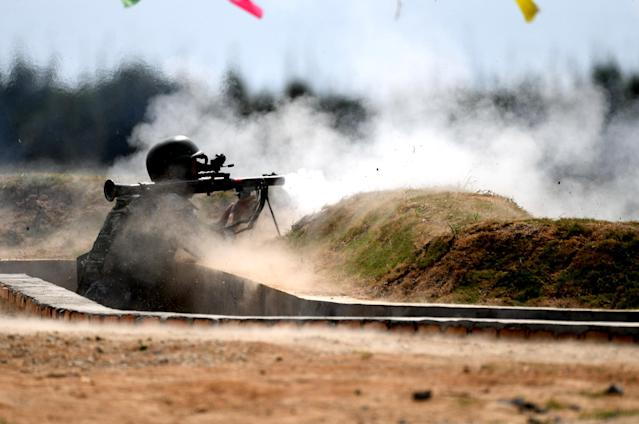 <p>A Chinese team member fires a rocket launcher in the survival trail event of the International Army Games 2018 'Seaborne Assault' on Aug. 2, 2018 in Quanzhou, Fujian Province of China. (Photo: Wang Dongming/China News Service/VCG via Getty Images) </p>