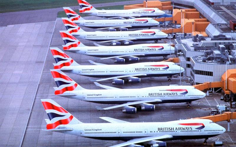 Line up of British Airways 747s with the BA logo on their tails - British Airways/PA
