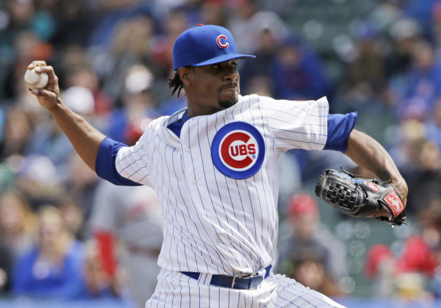2Chicago Cubs starter Edwin Jackson throws against the Cincinnati Reds during the first inning of a baseball game in Chicago, Saturday, April 19, 2014. (AP Photo/Nam Y. Huh)