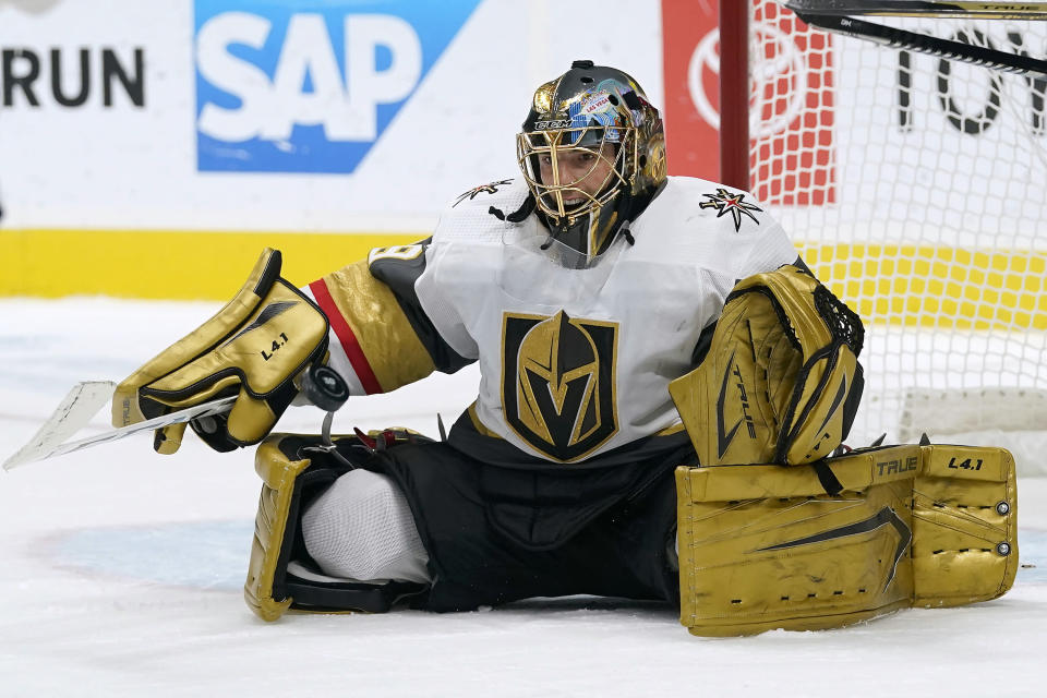 Vegas Golden Knights goaltender Marc-Andre Fleury defends on a shot by the San Jose Sharks during the first period of an NHL hockey game in San Jose, Calif., Saturday, March 6, 2021. (AP Photo/Jeff Chiu)