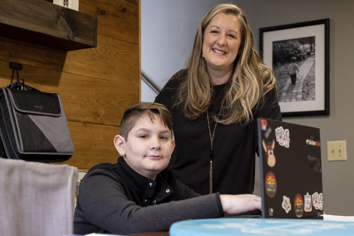 Kelli Rivera is photographed with her son Tate, 11 at their home in Roswell, Ga., Friday, Feb. 12, 2021. Rivera is hoping a voucher bill passes that will help pay for her to move her son out of a public Cobb County school and into a private school. (AP Photo/Ben Gray)