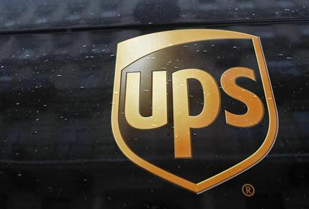 A United Parcel Service logo is seen on a car in center of Warsaw