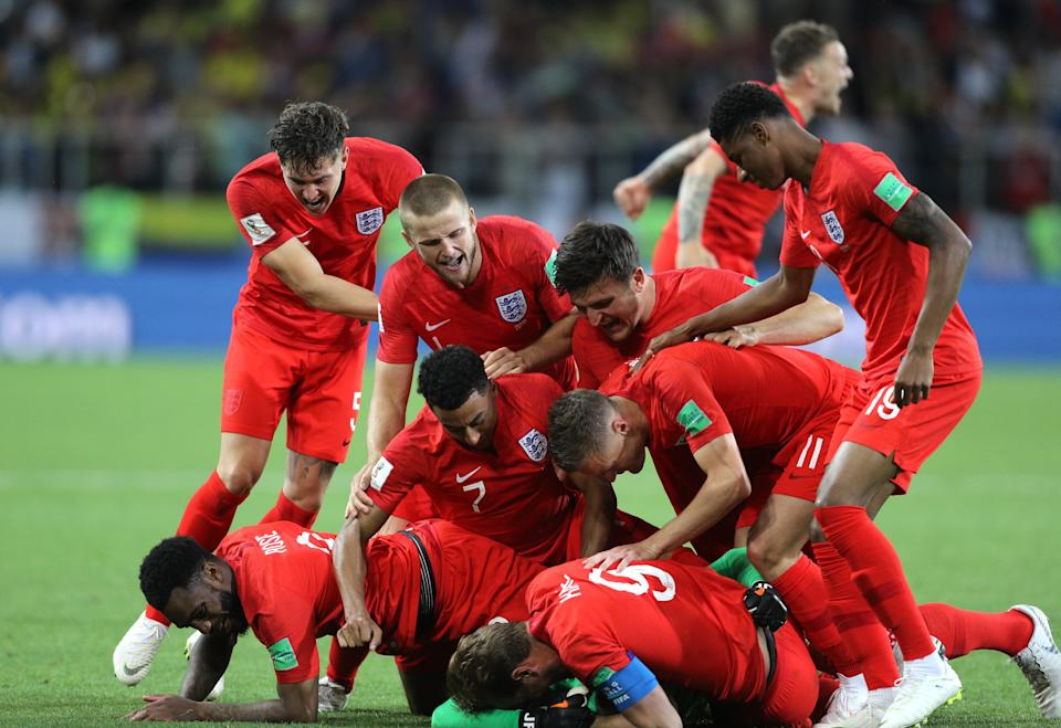 England celebrates after its round of 16 win over Colombia.