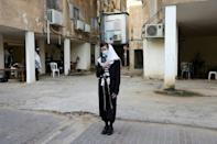 Israel has suffered from high rates of Covid-19 infections and prayers were moved outside synagogues in a bid to slow the spread of the virus
